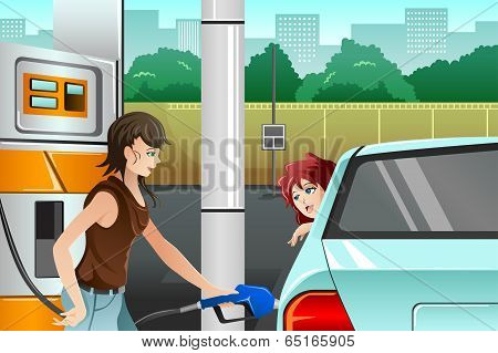 People Filling Up Gasoline At The Gas Station
