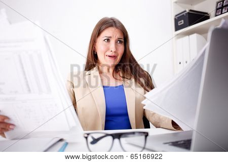 Business woman amazed and is shocked about costs in office