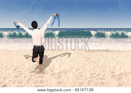 Happy Businessman Holding Snorkeling Gear