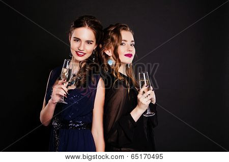 close-up  two young women with glasses of wine