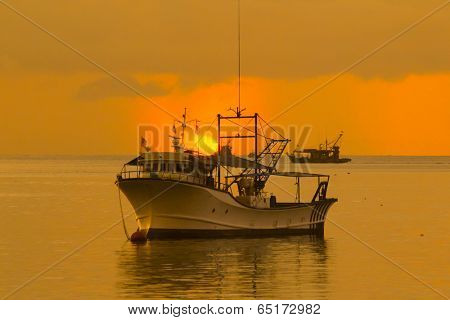Fishing Boats on sea at sunset