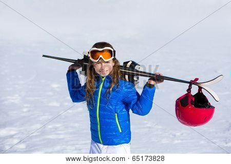 Kid girl winter snow holding ski equipment helmet goggles