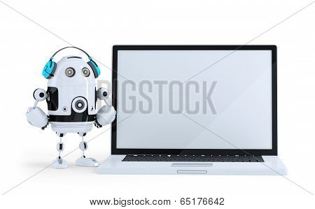 Robot With Headphone And Huge Laptop. Isolated. Contains Clipping Path