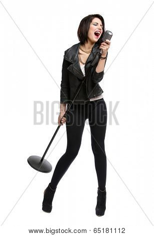 Full-length portrait of rock singer wearing leather jacket and keeping static mike, isolated on white. Concept of rock music and rave