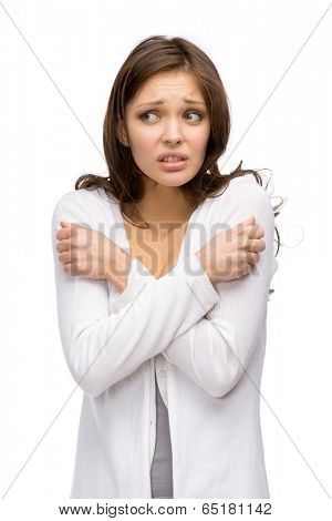 Half-length portrait of trembling woman, isolated on white. Concept of cold and chill