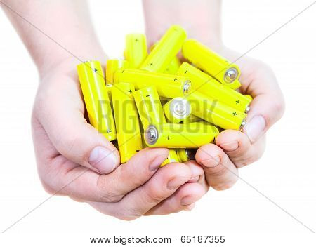 Caucasian Handful With Lot Yellow Penlight Batteries Isolated On White Background