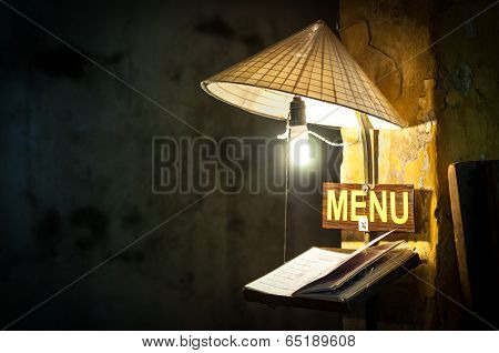Menu In Cafe Under Light Of Bulb In Rice Hat.