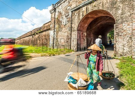 Woman With Baskets In Hue City, Vietnam, Asia.