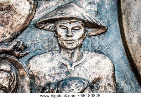Part Of Monument With Man In Hat In Vietnam, Asia.
