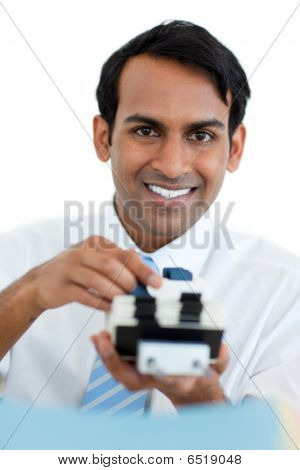 Smiling Businessman Searching For The Index
