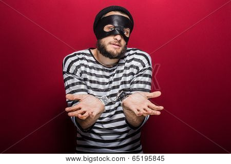 Confused thief with handcuffs