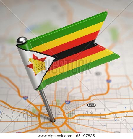Zimbabwe Small Flag on a Map Background.