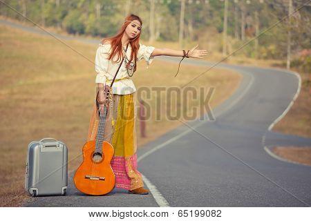 Hippie Girl Hitchhiking
