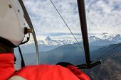 stock photo of ultralight  - Pilot flying an ultralight in Nepal - JPG