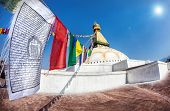 stock photo of nepali  - Prayer flags near Bodhnath stupa in Kathmandu valley Nepal - JPG
