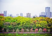 stock photo of smog  - Landscape view point of metropolis Osaka city with air pollution smog haze from Osaka castle Japan - JPG