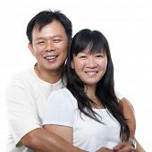 picture of southeast asian  - Happy southeast Asian mature couple hugging and smiling - JPG