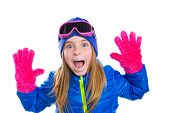 picture of nordic skiing  - blond kid girl winter snow portrait with open hands pink gloves shouting gesture - JPG