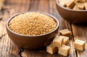 image of sugar cube  - Brown sugar in a bowl on a table - JPG