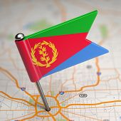 image of eritrea  - Small Flag State of  Eritrea on a Map Background with Selective Focus - JPG