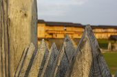 image of stockade  - Medieval protective wall of sharpened logs  - JPG