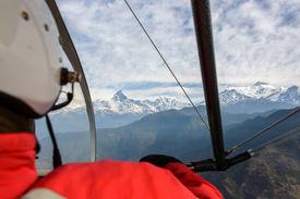 pic of ultralight  - Pilot flying an ultralight in Nepal - JPG