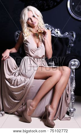 Sexy Woman With Blond Hair With Glass Of Champagne