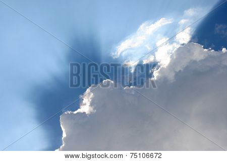 Blue Sky With Clouds And Sunbeams