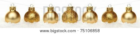 Christmas border of baubles in snow isolated