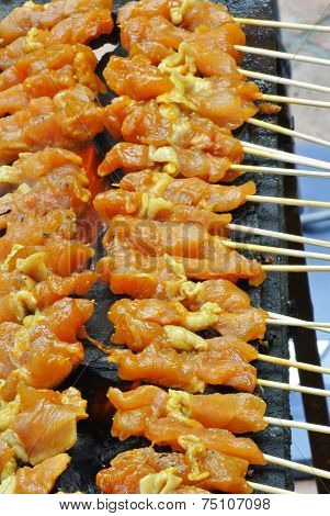 Malaysia Chicken Satay Cooking on a Hot Charcoal Grill