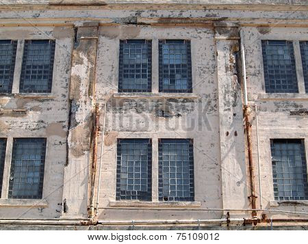 Prison Facilities Rusted Windows On Exterior Wall