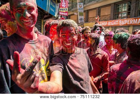 KATHMANDU, NEPAL - MARCH 26: People covered in paint on Holi festival, March 26, 2013, Kathmandu, Nepal. Holi, the festival of colors, marks the arrival of spring.