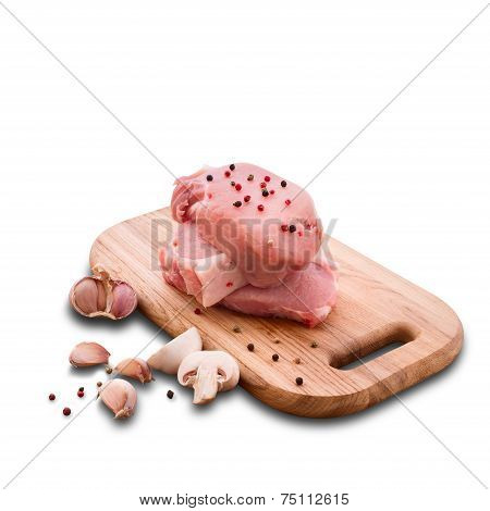 Food sliced pieces of raw Meat for barbecue with fresh Vegetables and Mushrooms on wooden surface.