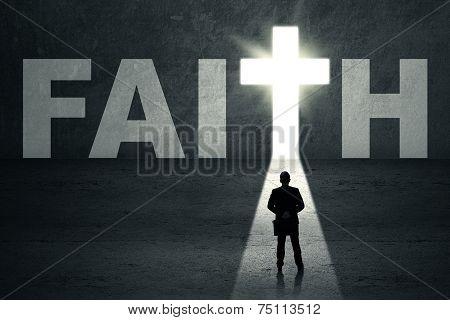 Businessman In Front Of Faith Door