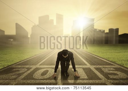 Businessman Kneeling On Track