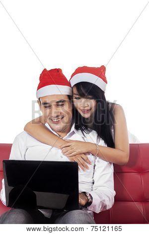 Young Couple Buy Online In Studio