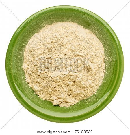 maca root powder in an isolated green ceramic bowl
