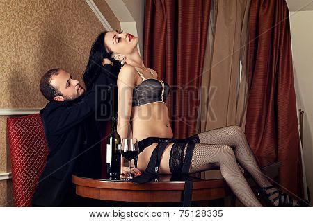 man holding a sensual woman