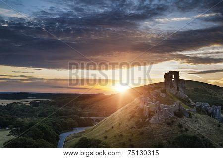Castle Ruins Landscape At Sunrise With Inspirational Sunburst Behind Castle