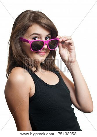 Portrait of cute teen girl with pony tails and sun glasses looking at camera on white background