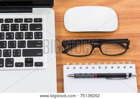 Blank Business Laptop, Mouse, Pen, Note And Glasses