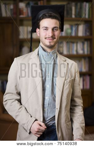 Happy Young Man Graduating From College, With Graduation Hat