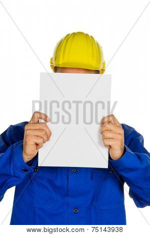 a craftsman holding a blank sheet in hand