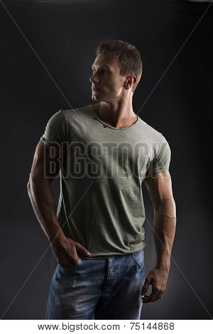 Handsome Muscular Fit Young Man Looking To A Side