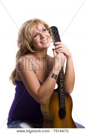 Blonde Girl Sitting With Guitar