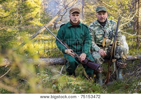 Two Older Hunters Rest