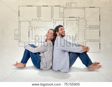 Young Couple Dreaming And Imaging Their New House In Real State Concept