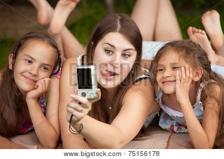 Portrait Of Mother And Daughters Making Faces On Self Shot