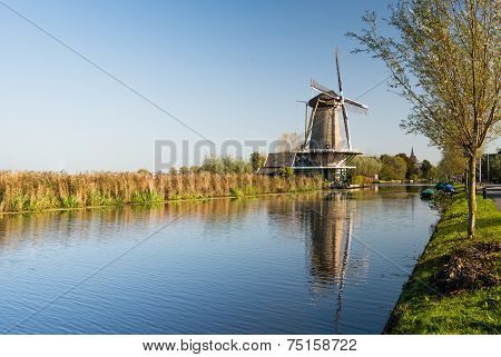 Dutch Canal With Windmill