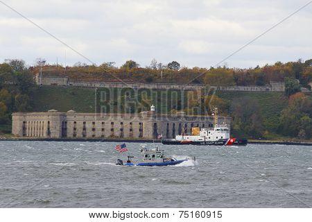 NYPD boat and US Coast Guard Ship providing security during New York City Marathon 2014
